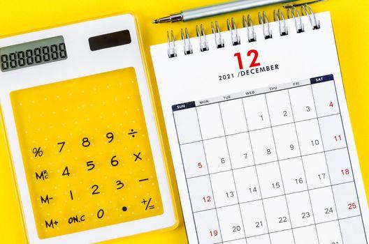 December 2021 desk calendar with calculator