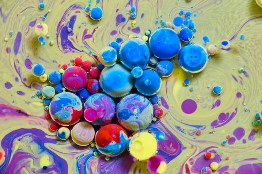 Rainbow spheres on yellow and purple silky surface