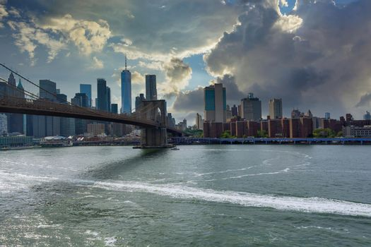 View beautiful sunset cityscape over Lower Manhattan in New York City United States America on panorama view on skyline of Brooklyn bridge