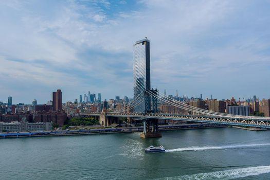 Manhattan Bridge with Manhattan New York City skyscrapers city over Hudson River.