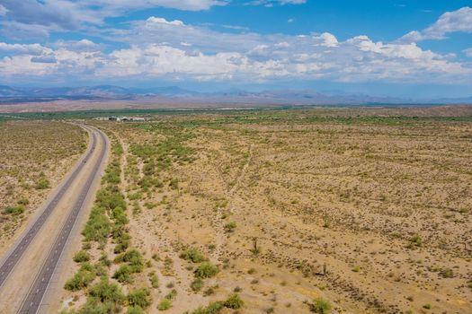 Arizona desert landscape canyon mountain in saguaro cactus near Interstate highway
