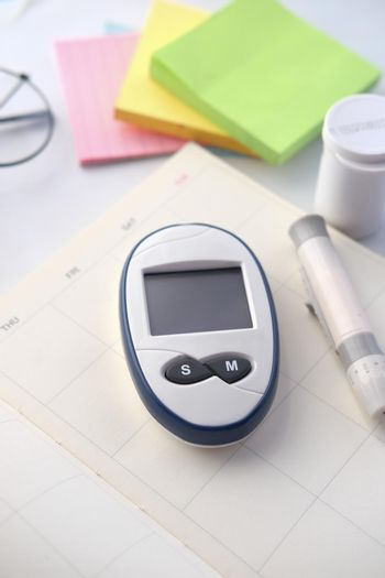 diabetic measurement tools on a planner on table
