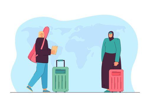 European and Arabic female travelers with luggage