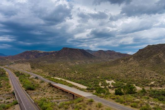 Panorama view of mountains desert in the middle of the highway of Arizona