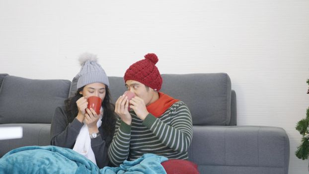 couple husband and wife smile relaxing. drinking tea in winter holiday