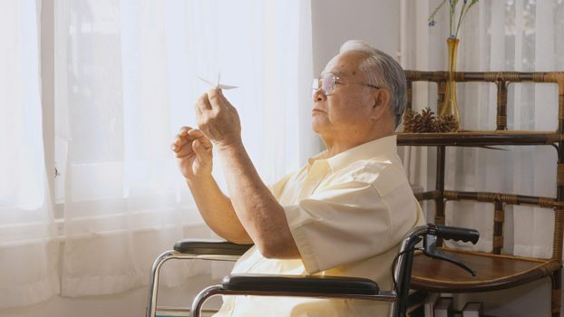 Pensive disabled elderly patient sit on wheelchair alone