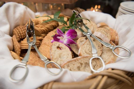 Bread and cracker basket with serving tongs