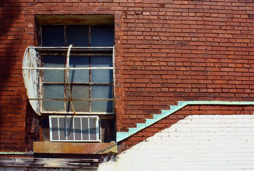 Window on a red brick wall with teal accent