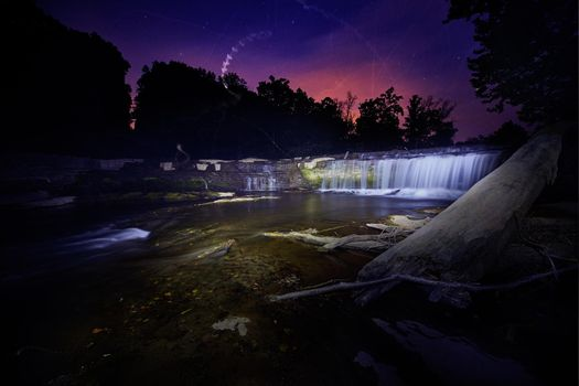 Ghostly lights in a purple dusk with waterfalls at Cataract Falls