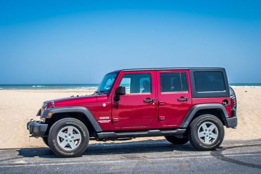 South Padre Island, TX, USA - March 3, 2019: A Jeep Wrangler Unlimited Sports parked along the preserve island