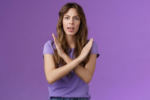 Quit fooling around. Serious-looking woman bad mood bossy angry make cross fighting lgbtq rights demand stop discrimination forbidding cruel behaviour say no purple background