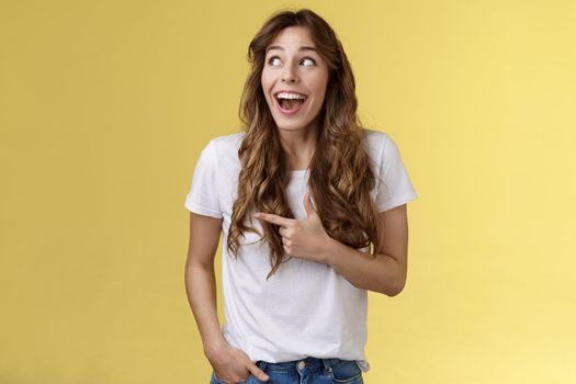 Funny amused cute girlfriend enjoy awesome party having wonderful time spend amazing day city fair open mouth surprised fascinated observe admiration lgbtq pride parade happy yellow background
