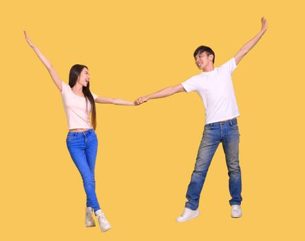 young  couple being happy and dancing