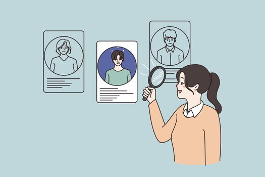 Woman use magnifier lens choose candidates for work position