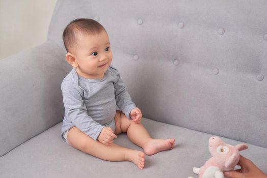 Smiling baby girl toddler in white bodysuit