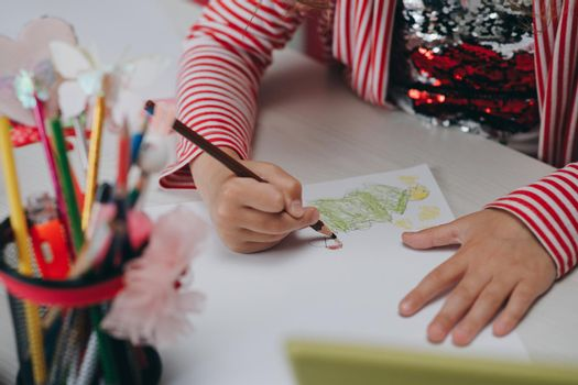 Hands of kid who is involved by drawing. Creative hobby, lifestyle drawing. Artist concept. Talented Innovative Female Artist Draws with Her Hands