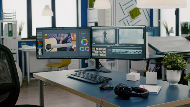 Modern creative workplace with nobody in and dual displays setup