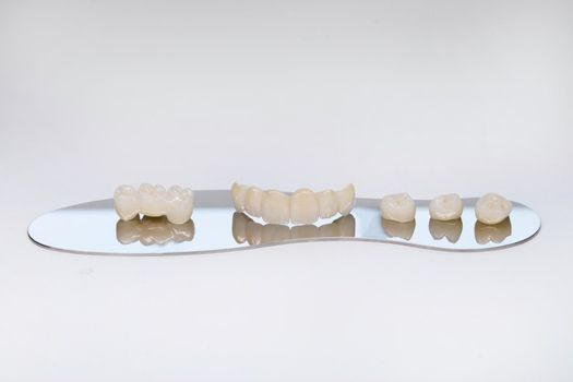Zirconium tooth crown. Isolate on background. Aesthetic restoration of tooth loss. Ceramic zirconium in final version. Metal Free Ceramic Dental Crowns
