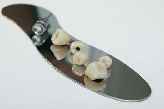 Zirconium dental crown artificial chewing tooth with orthopedic screwdriver. zirconium crown and zirconium hybrid abutment.