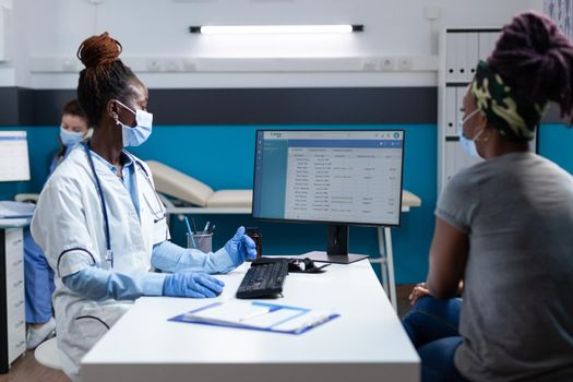 African american physician doctor analyzing clinical consultation