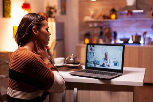 Woman with sickness calling doctor on online video conference
