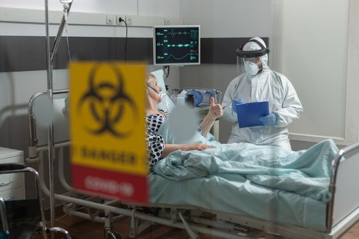 Doctor wearing ppe protection suit against contamination with covid-19