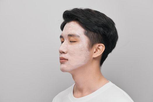 Cosmetology man portrait with mud healthy scrub