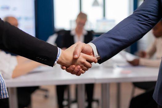 Satisfied businessman company employer wearing suit handshake new employee