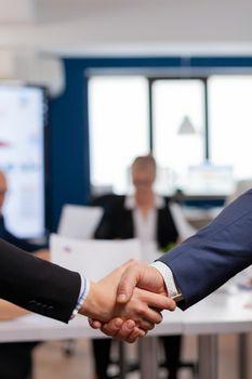 Satisfied businessman company employer wearing suit handshake