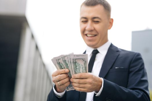 World economic crisis. Businessman Counting Money Usd Bills Payday. Total unemployment in a pandemic. Bribe. Dirty money. Successful business. Symbol of success, gain, victory