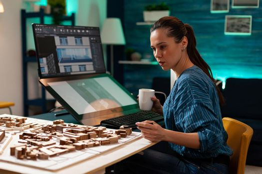 Woman with architect occupation working on blueprint
