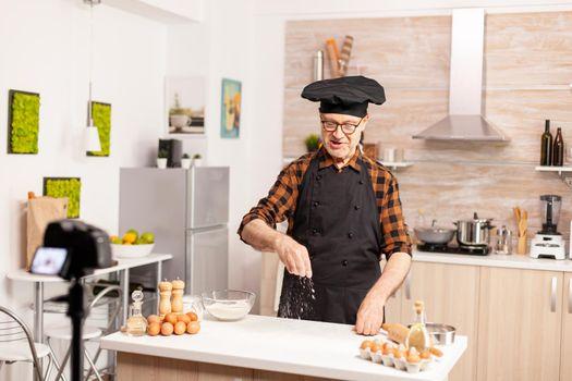 Experienced senior chef recording tutorial