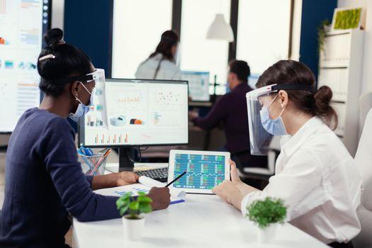 Financial team of big corporation doing financial analysis