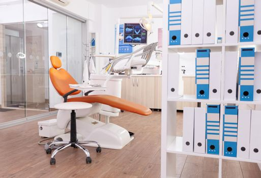 Empty stomatology orthodontic office room with nobody in it