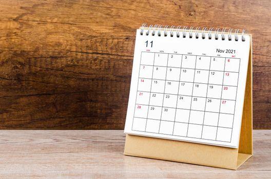 November desk calendar 2021 on the table.