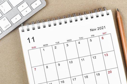 November 2021 desk calendar with pencil.