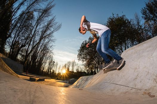 Skateboarder on wall turn