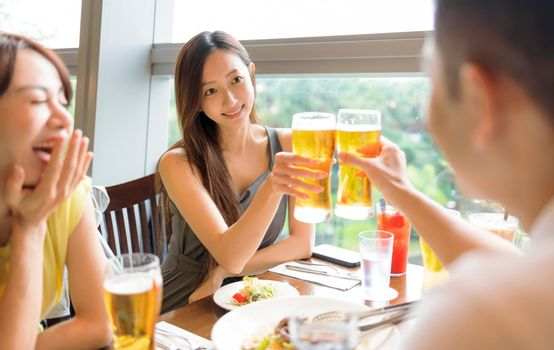 People enjoying food and drink in restaurant