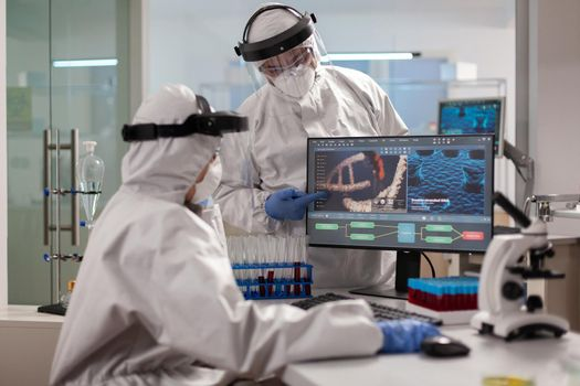 Healthcare specialists dressed in ppe suit working to discover virus vaccine