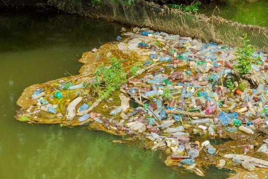 River pollution plastic bottles other trash on garbage on plastic