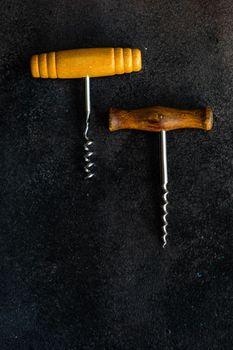 Vintage corkscrew on rustic background