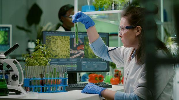Biochemistry doctor examining chemical test under microscope