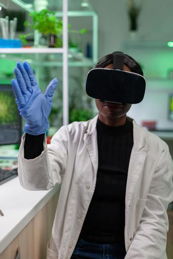 Botany genetic scientist doing reseearch using virtual reality