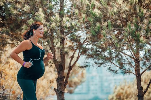 Pregnant Woman Jogging in the Park