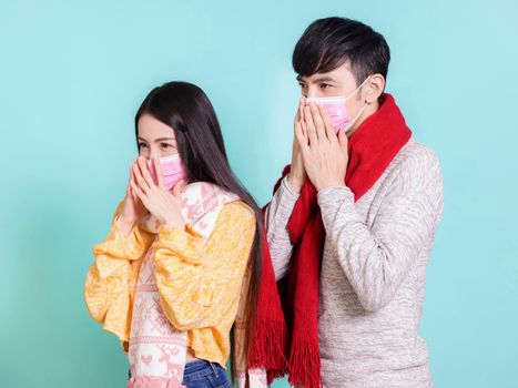 Young couple wearing medical masks and winter casual clothing