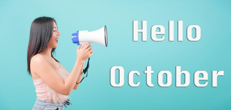 Hello October, Asian happy portrait beautiful young woman standing smile her holding her Shouting through a megaphone