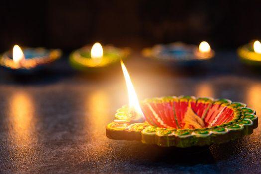 clay lit light a fire already on Diya or oil lamp