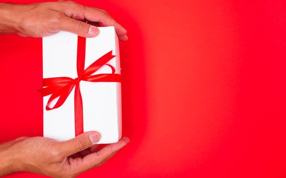 Happy New Year and Christmas 2020 or valentine day, top view hands with white gift box