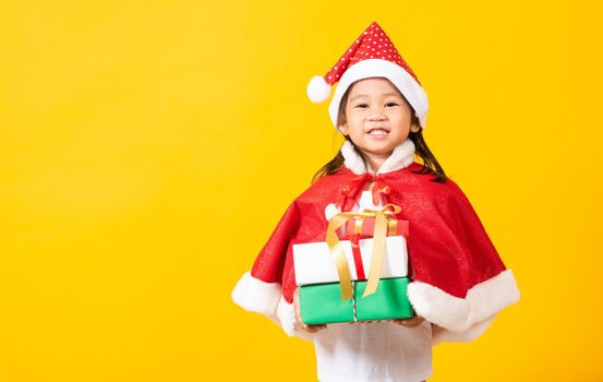 Kid dressed in red Santa Claus hat hold gift box on hands