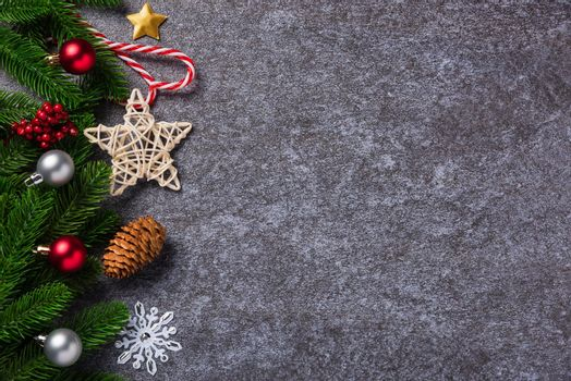 fir tree branches with Xmas ornaments and the star